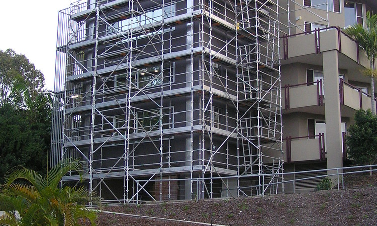 Steel scaffolding on the side of 5 storey apartment block